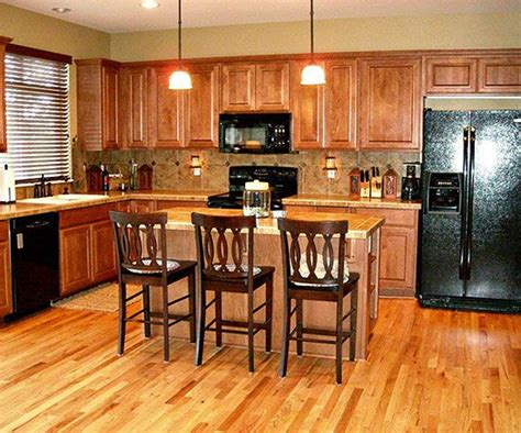 what are the best tiles for kitchen floors 25 best ideas about kitchen black appliances on 9908