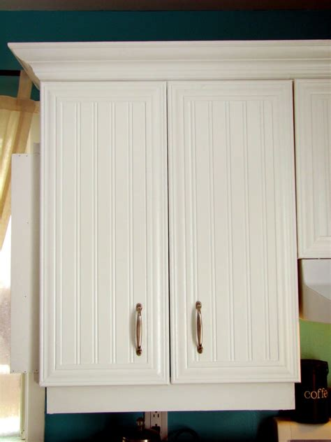 refacing kitchen cabinets with beadboard beadboard and molding on cabinet doors we could actually 7702
