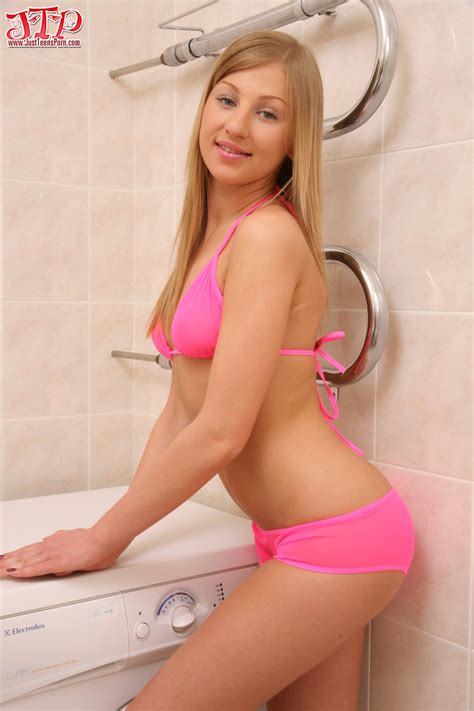 Lovely Blonde Teen Is Posing In Sexy Pink Bikini And Then