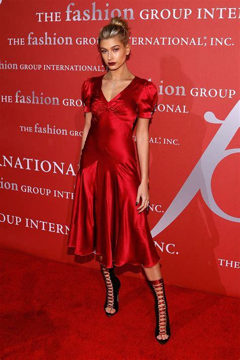 hailey baldwin   fire    red dress hellogiggles