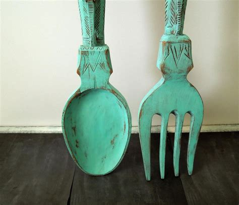 You need to collect few waste plastic spoons and few crafting supplies like #6 plastic spoon: 20 Best Giant Fork and Spoon Wall Art | Wall Art Ideas