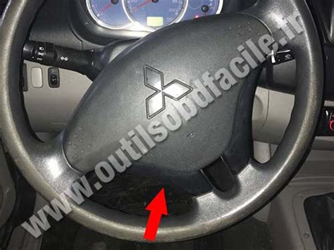 obd connector location  mitsubishi
