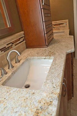 colonial gold bathroom vanity top  cherry cabinets