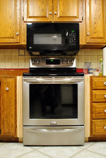 If you plan on refinishing the cabinets, you can also use wood end of suggested clip. Filling Gaps Around The Stove With Trim & Other Little Things   Young House Love