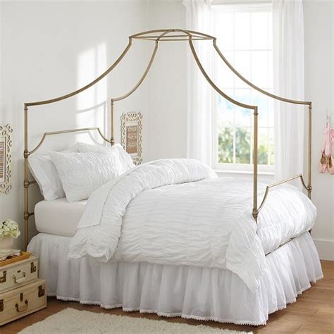 37037 gold canopy bed create a chic glam space with emily meritt s pottery
