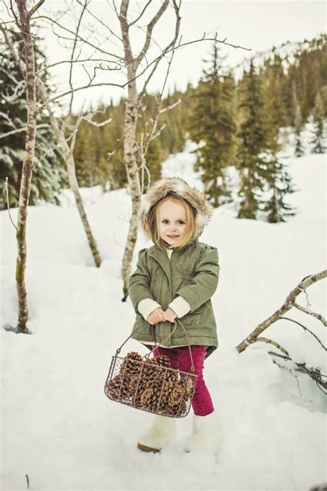 winter family  girl pine cones basket fur boots
