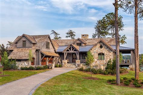 wrap around porch home plans timber frame home with farmhouse interiors overlooking