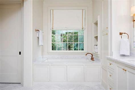 wainscoting panels  bathtub transitional bathroom