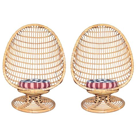 two 1960s egg shaped easy chairs in rattan easy chairs
