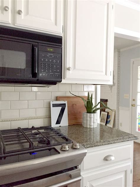 pictures of white kitchen cabinets with granite our white kitchen cabinets granite emily a clark