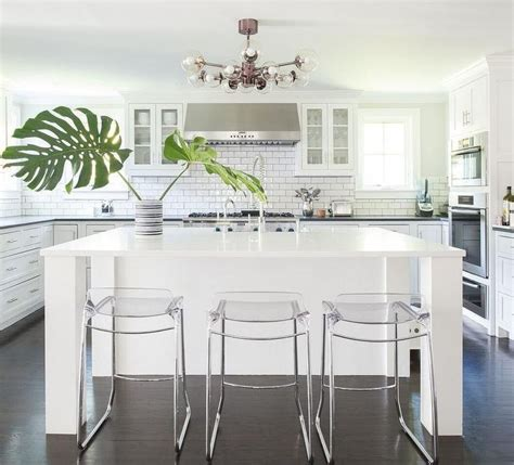 Kitchen Island Stools And Chairs by Stunning Monochromatic White Kitchen Features Three Clear