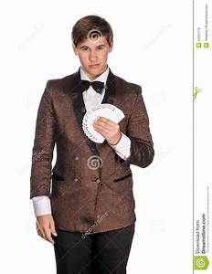 Young Magician In Suit Holding Playing Cards Royalty Free ...