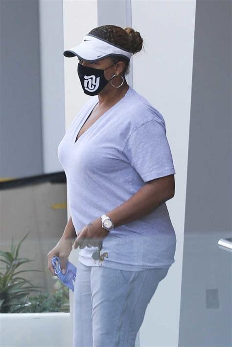 queen latifah   black protective mask  money   atm  beverly hills celeb donut