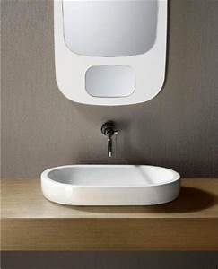 Flat sleek oval shaped ceramic vessel sink by gsi for Flat bathroom sinks