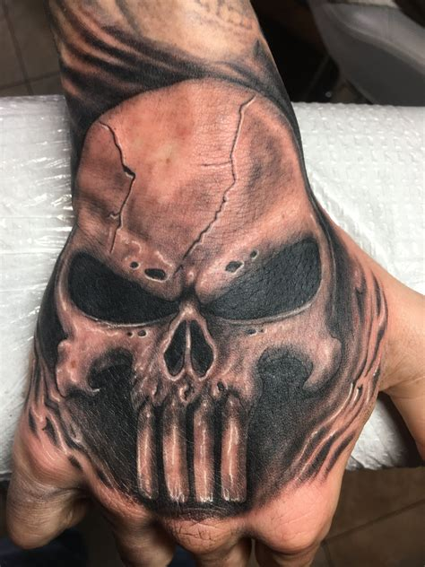 punisher skull tattoo  travis skulltattoo handtattoos