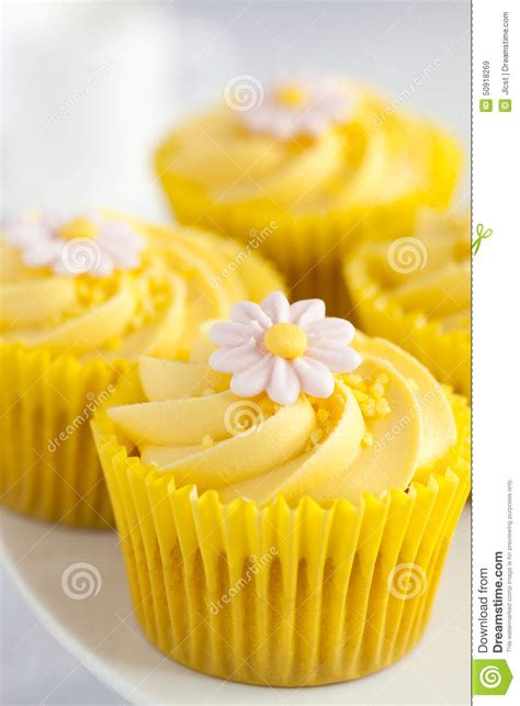 Lemon Cupcakes With Butter Cream Swirl And Fondant Flower
