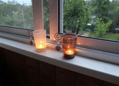 candles two burning holders candle vensterbank kaarsen windowsill metal street twee branden