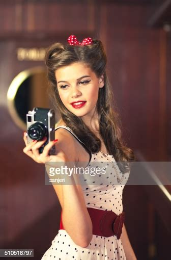 Beautiful Pin Up Girl With Camera Stock Photo Getty Images