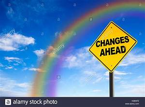 Changes Ahead sign against a blue sky with rainbow ...