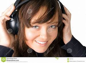 The Girl Listening To Music Through Ear-phones Stock ...