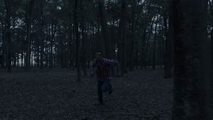 Man Frantically Running Away From Something In Dark Forest ...