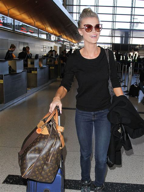 celebs carry   carry ons   bags  louis vuitton louboutin chanel purseblog