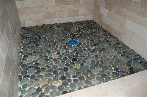 pebble rock shower floor natural stone wall tile architectural design