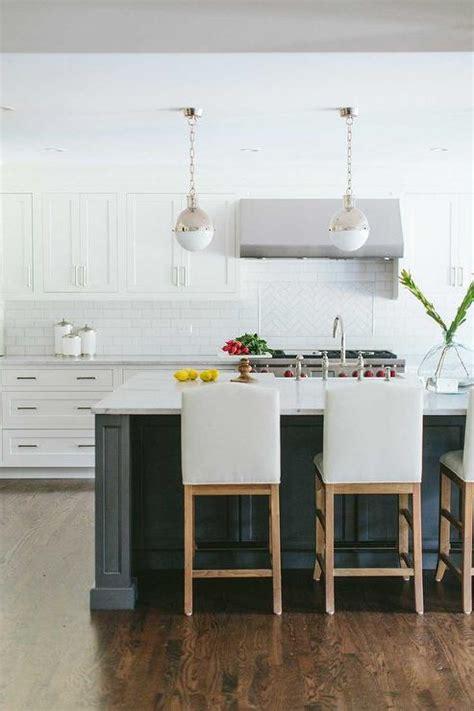 white kitchen stools white camelback counter stools transitional kitchen