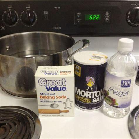 clear  clogged drain salt baking soda vinegar