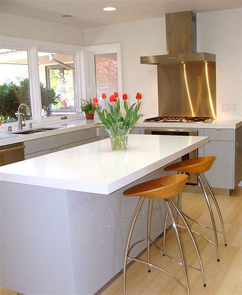white kitchen with stainless steel backsplash inspiration from kitchens with stainless steel backsplashes 2106