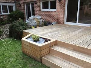 Aménagement paysager autour d'une terrasse en chêne et d'un bassin GALAXY JARDIN