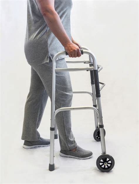 walker aids handicapped mobility walkers adult rolling wheels front tips testing legs someone support rubber features forward buying leg instead