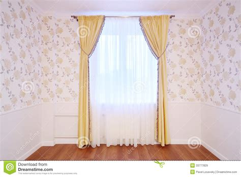 light window with curtains in cozy and simple room royalty