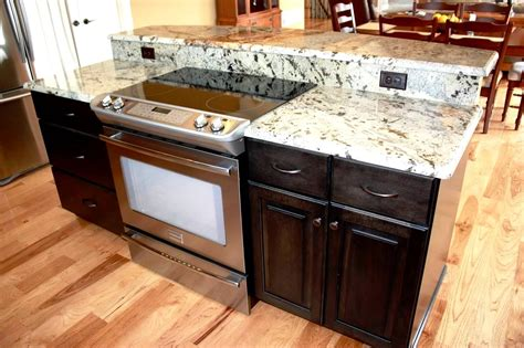 small kitchen island with cooktop island with storage slide in range and breakfast bar 8070