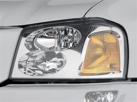 image 2009 gmc envoy 2wd 4 door sle headlight size 1024