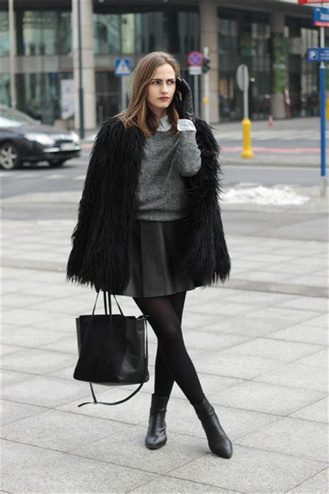 So in carmel blogger leather skirt grey sweater black bag black boots fluffy winter ...