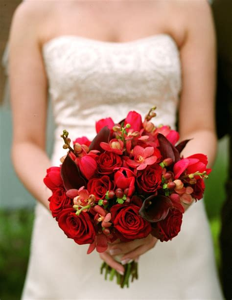 red rose red hypericum red orchid bouquet red bouquets