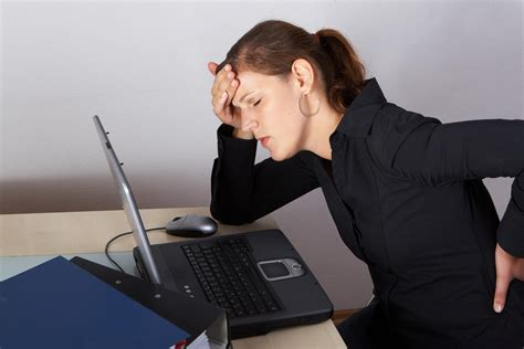 back pain from sitting at desk office workout 5 exercises to do at your desk