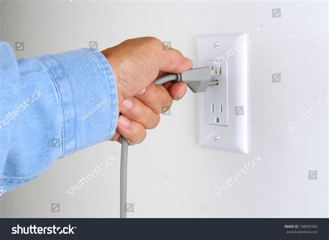 Closeup Mans Hand Inserting Electrical Plug Stock Photo