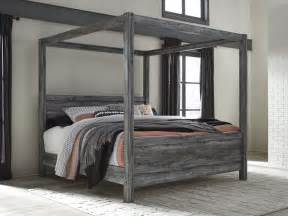 canopy king bed baystorm gray king canopy bed from coleman furniture