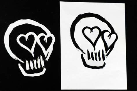 5sos logo skull