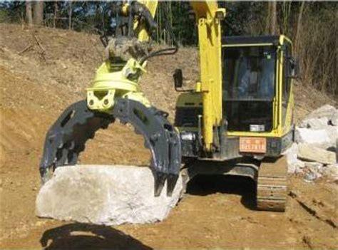 rock grapple attachment adds versatility   excavator   excavator  good