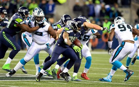 rawls scores  touchdowns  seahawks demolish panthers