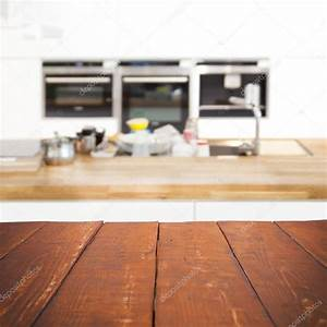 Empty wooden table and blurred kitchen background — Stock