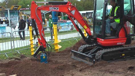mini excavator working  auger youtube