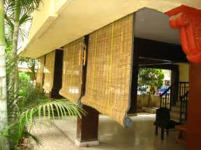 Custom Roll Up Patio Shades by Exterior Brown Bamboo Roll Up Window Blind Hanging On