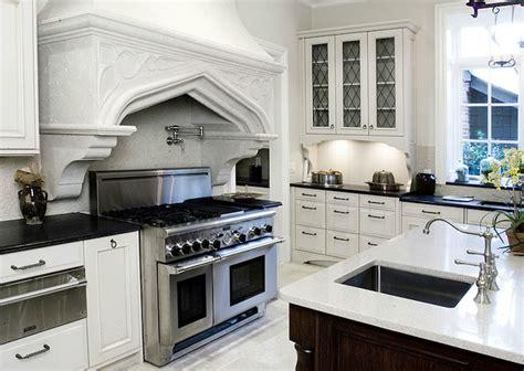 Glass Front Kitchen Cabinets - Mediterranean - kitchen