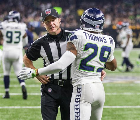 seahawk earl thomas  fined  hugging official