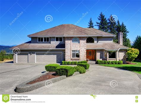 Luxury Brick House With Beautiful Curb Appeal Stock Photo