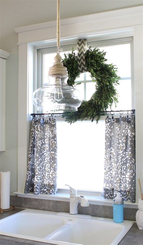 boxwood wreath  top  small curtains  kitchen window
